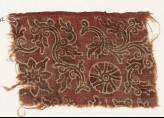 Textile fragment with curving vines, quatrefoil, and rosette (EA1990.802)