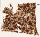 Textile fragment with branches and leaves (EA1990.821)