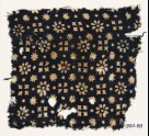 Textile fragment with rosettes, dots, floral shapes, and squares (EA1990.83)
