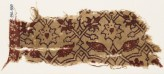 Textile fragment with interlacing tendrils, flowers, and leaves (EA1990.838)