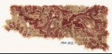 Textile fragment with swirling tendrils and flower-heads (EA1990.852)