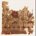 Textile fragment with flowers and interlace (EA1990.866)