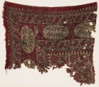 Textile fragment with flowers and Arabic inscription
