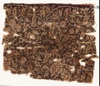 Textile fragment with tendrils and flowers, possibly from a garment (EA1990.882)