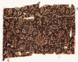 Textile fragment with tendrils and flowers, possibly from a garment (EA1990.883)