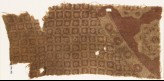 Textile fragment with linked squares and ornate flower-heads