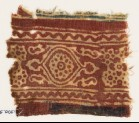 Textile fragment with medallion and linked stars (EA1990.904)