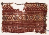 Textile fragment with bands of quatrefoils, rosettes, and chevrons (EA1990.907)