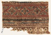 Textile fragment with diamond-shapes, circles, and arches (EA1990.917)