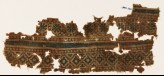 Textile fragment with rosettes and stepped diamond-shapes (EA1990.920)