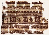 Textile fragment with bands of squares, diamond-shapes, and rosettes (EA1990.926)