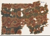 Textile fragment with tendrils and vine leaves (EA1990.960)