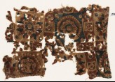 Textile fragment with squares, rosettes, and flower-heads (EA1990.977)