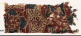 Textile fragment with medallion, wings, and rosettes (EA1990.979)