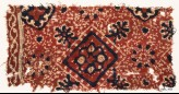 Textile fragment with square, flower-heads, rosettes, and medallions (EA1990.990)