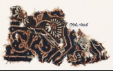 Textile fragment with curving tendril, leaves, and a flower (EA1990.1006)