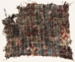 Textile fragment, possibly with medallions and cartouches (EA1990.1016)