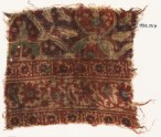 Textile fragment with stars, interlace, and possibly linked medallions (EA1990.1017)