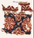 Textile fragment with flowers and trefoils (EA1990.1021)