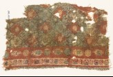Textile fragment with grid of quatrefoils and serrated crosses (EA1990.1027)