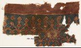 Textile fragment with linked hearts and arches (EA1990.1030)
