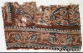 Textile fragment with leaves and linked flowers (EA1990.1033)