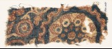 Textile fragment with tendrils, circles, and flower (EA1990.1065)