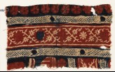 Textile fragment with crossed tendrils and rosettes (EA1990.1090)