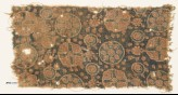 Textile fragment with circles, rosettes, and crosses (EA1990.1101)