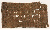 Textile fragment with linked circles and rosettes (EA1990.1102)