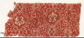 Textile fragment with tendrils, ovals, and flowers (EA1990.1110)