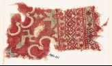 Textile fragment with stars, swastika, and possibly rosettes (EA1990.1111)