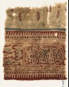 Textile fragment with stylized plants, a cartouche, and interlace (EA1990.1116)