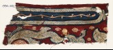 Textile fragment with cross-hatched frame and leaves (EA1990.1142)