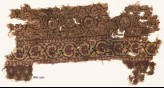 Textile fragment with flower-heads, tendrils, and vine