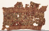 Textile fragment with Persian-inspired script and interlace (EA1990.1176)