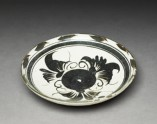 Cizhou type dish with floral decoration (oblique)