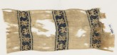Textile from a scarf or girdle with scrolling tendrils and flowers (EA1993.112)