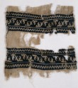 Textile from a scarf or girdle with leaves and chevrons