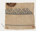 Textile fragment from a towel with stylized birds