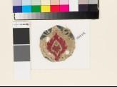 Roundel textile fragment with stylized leaf (EA1993.275)
