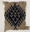 Textile fragment with hands and diamond-shaped medallion