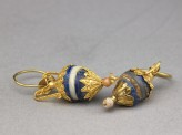 Gold earrings with lapis lazuli, ivory, and quartz pendants