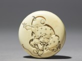 Manj netsuke with a boy playing with a spinning top