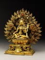 Seated figure of a female deity, possibly Tara, with a mandorla of flames