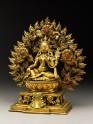 Seated figure of a female deity, possibly Tara, with a mandorla of flames