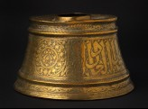 Base of a candlestick with inscription