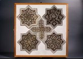 Set of five tiles in the shapes of stars and a cross