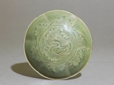 Greenware bowl with ducks amid waves (top)