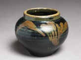 Black ware jar with leaf design (oblique)